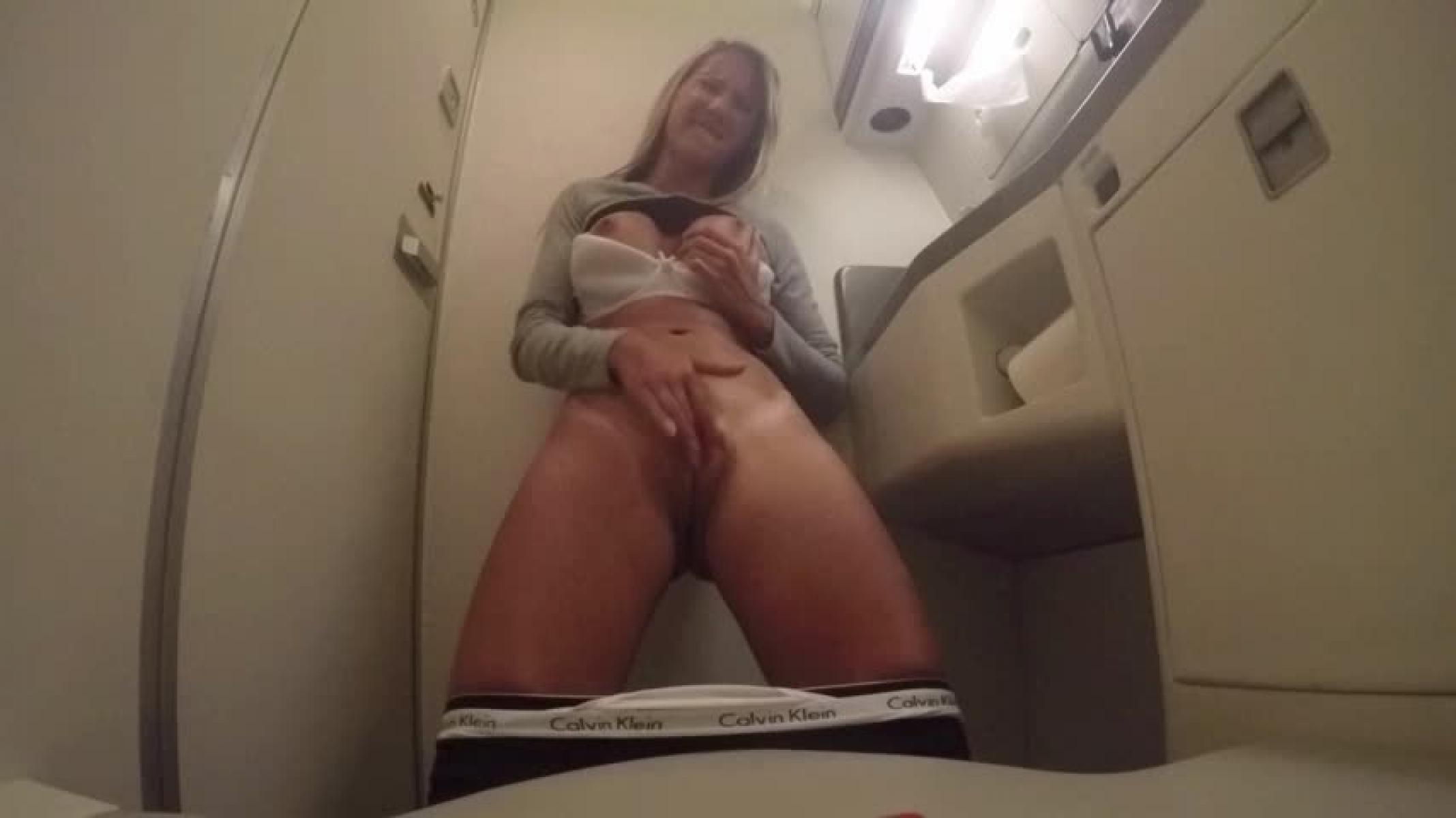 Shameless girl masturbates and have strong orgasm on a plane