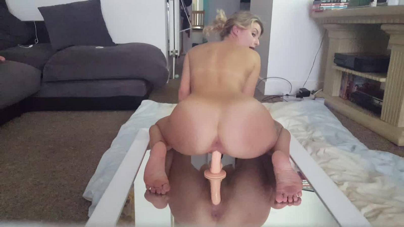 Perfect ass rides a huge dildo until she cums hard